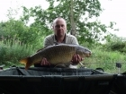 Adrian Knowless 17lbs 8oz common carp from turf pool using code red 18mm.. seen few fish top so code red boilies  on the deck