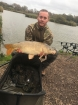 15lbs 9oz Carp from Burnham on sea holiday village using Nash Pineapple.. 15lb.9oz common carp caught on the specimen lake.peg 25 straight off the opposite island.very strong winds and rain