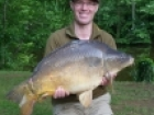 Paul Fletcher 27lbs 4oz Mirror Carp from Etang de Cosse using CC Moore Odyssey XXX 10mm.. Caught fishing to dam wall margins 5 yards from bank on Century NG 2.75tc rod, 16lbs Suffix Flourocarbon