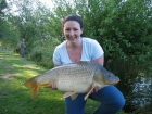 Elizabeth Fletcher 24lbs 10oz Common Carp from Les Burons Carp Fishing using Mainline Fusion.. Caught fishing to island in 2 feet of water. Caught using Century NG Rod, Shimano Baitrunner reel, Fox