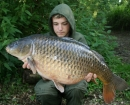 23lbs 8oz Common Carp from Carthagena Fishery using Nash Bait.. I found a nice silt patch which I had seen fish feeding on but was unable to present a bait on it properly because it was so packed