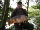 Chris Morley 23lbs 0oz mirror carp from Rookley Country Park using carp company - ice red.