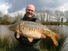 29lbs 3oz Mirror Carp from La Glehias using Quest Baits Rahja Spice.. Caught on gap in trees on far margin.