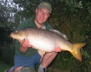 Paul Fletcher 24lbs 8oz Common Carp from Les Burons Carp Fishing using Mainline Fusion.. Caught fishing to far bank reeds (in front of house). Using Century NG Rods, Shimano 6000GTE reels, 15lbs