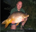 27lbs 6oz Mirror Carp from Les Burons Carp Fishing using Mainline Fusion.. Caught fishing to left hand island. Using Century NG Rods, Shimano 6000GTE reels, 15lbs Shimano Catana Line, Korda Grippa,